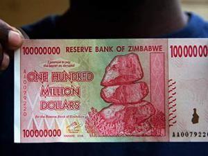 Купюра номиналом 100 триллионов зимбабвийских долларов